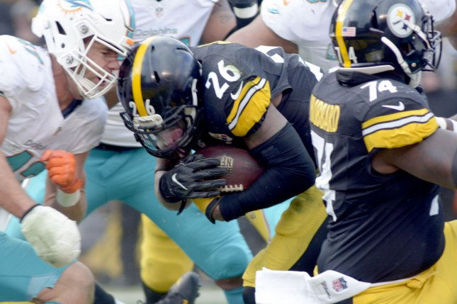 Pittsburgh Steelers running back Le'Veon Bell (26) scores on a one yard touchdown run against the Miami Dolphins in the second quarter of the AFC Wild Card Playoff game at Heinz Field in Pittsburgh on January 8, 2017. Photo by Archie Carpenter/UPI
