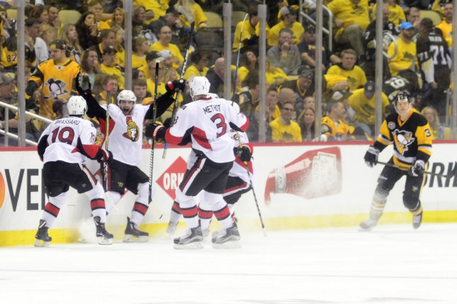 Ottawa Senators right wing Bobby Ryan (9) scores the game winner early in the overtime period against the Pittsburgh Penguins in game one of the Eastern Conference Finals of the Stanley Cup Playoffs at PPG Paints Arena in Pittsburgh on May 13, 2017. Photo by Archie Carpenter/UPI