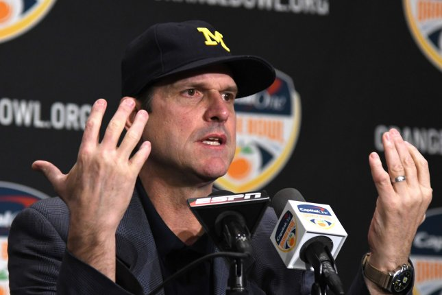 Michigan Wolverines Head Coach Jim Harbaugh answers questions from the media uring the Orange Bowl Head Coaches press conference at the Renaissance Fort Lauderdale Cruise Port hotel on December 29, 2016 in Fort Lauderdale, Florida. The Orange Bowl game will be played Friday, December 30, 2016 at the Hard Rock Stadium in Miami, Florida. File photo by Gary I Rothstein/UPI