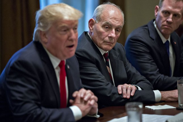John Kelly, White House chief of staff, center, listens as U.S. President Donald Trump, left, speaks. Kelly on Thursday denied reports he is close to leaving the administration. Photo by Andrew Harrer/UPI