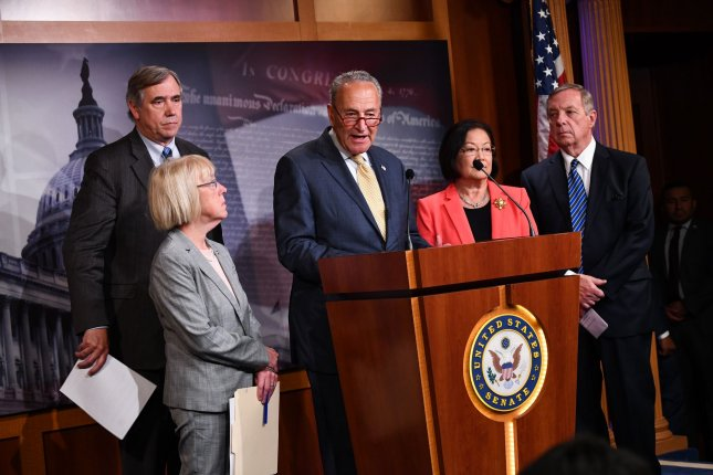 From left to right, Democratic Sens. Patty Murray, Dick Durbin, Chuck Schumer, Mazie Hirono and Jeff Merkley hold a press conference to discuss a bill to end family separations at the border on Thursday. Photo by Kevin Dietsch/UPI