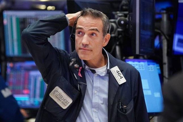 A trader works on the the floor of the New York Stock Exchange on on August 23 in New York City. Photo by John Angelillo/UPI