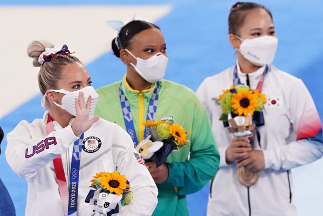 Team USA gymnast Mykayla Skinner (L), stands on stage with Brazil's Rebeca Andrade (C) and South Korea's Seojeong Yeo at the presentation ceremony for the women's vault final at the 2020 Summer Games on Sunday in Tokyo. Photo by Richard Ellis/UPI