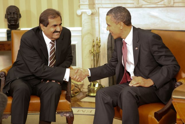 U.S. President Barack Obama meets with with Amir Hamad bin Khalifa al-Thani of Qatar in the Oval Office of the White House in Washington on April 14, 2011. UPI/Gary Fabiano/POOL
