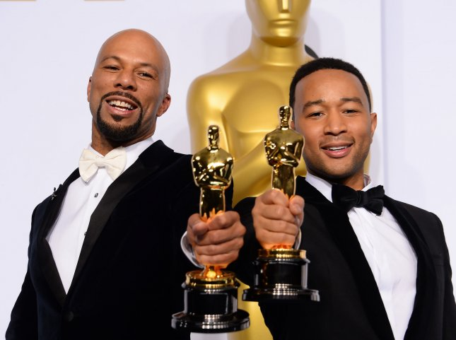 Common and John Legend, winners of Best Song for Glory in Selma, pose backstage with their Oscars during the 87th Academy Awards at the Hollywood & Highland Center in Los Angeles on Feb. 22, 2015. Photo by Jim Ruymen/UPI
