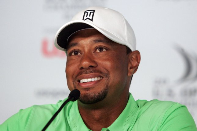 Tiger Woods speaks to the media ahead of the U.S. Open Championship on June 16. The golfer denied a tabloid report that he cheated on Lindsey Vonn with Amanda Boyd. Photo by Jim Bryant/UPI