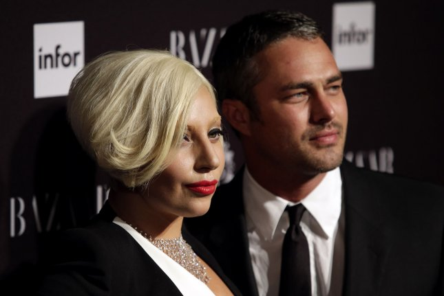Lady Gaga (L) and fiancé Taylor Kinney at the Harper's Bazaar Icons party on September 5, 2014. The singer recently modeled bridal looks for CR Fashion Book. Instagram/John Angelillo/UPI