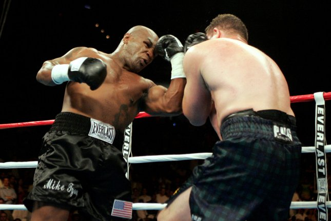 A new poll shows graduated student loan borrowers would go to extremes like cutting off a pinky finger or taking a punch from boxer Mike Tyson to pay off the debt. Pictured: Tyson (L) battles Kevin McBride of Clones, Ireland, during their heavyweight fight on June 11, 2005. McBride won in the 6th round with a TKO. Photo by Roger Williams/UPI