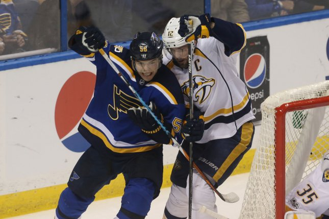 St. Louis Blues' Magnus Paajarvi and Nashville Predators' Mike Fisher (right) tie up behind the net in the first period at the Scottrade Center in St. Louis on April 26, 2017. File photo by Bill Greenblatt/UPI