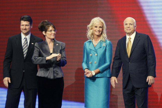 Todd Palin, husband of vice presidential candidate Alaska Gov. Sarah Palin, and Cindy McCain, wife of Republican presidential candidate Sen. John McCain, stand on stage together on the last day of the Republican National Convention in Minnesota in 2008. File Photo by Brian Kersey/UPI