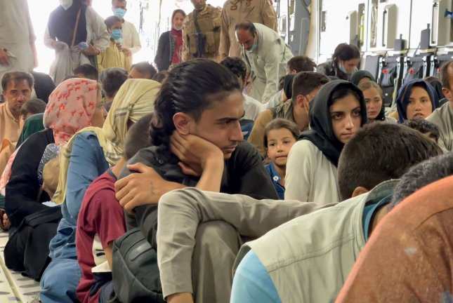 Refugees are evacuated from Hamid Karzai International Airport in Kabul, Afghanistan, on August 26. Photo by Hassan Majeed/UPI
