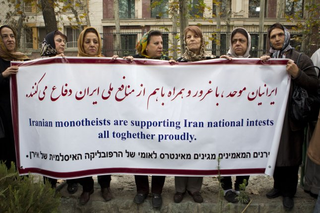 Iranian Jewish women gather in front of United Nation office to show their support for Iran's nuclear program in Tehran, Iran on November 19, 2013. Senior Iranian parliamentary officials said Iran would stop negotiating with the world powers if the U.S. congress passed new sanctions against Iran. UPI/Maryam Rahmanian