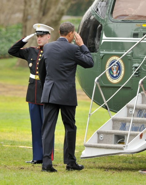 United States President Barack Obama salutes the Marine Honor Guard as he boards Marine 1 as he departs from the South Lawn of the White House in Washington en route to Allentown, Pennsylvania to discuss jobs and the economy before returning late in the afternoon on December 4, 2009. UPI/Ron Sachs/POOL