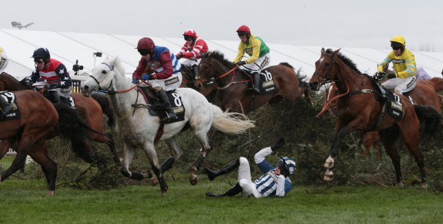 Jockeys jump the famous Chair in the 2014 Crabbies Grand National race on his horse at odds of at Aintree,Liverpool Saturday April 05 2014. (UPI Photo/Hugo Philpott)