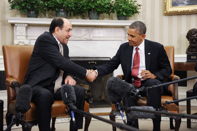 Iraqi Prime Minister Nouri Al-Maliki (L) shakes hands with U.S. President Barack Obama in the Oval Office at the White House in Washington, DC, November 1, 2013. (UPI/Olivier Douliery/Pool)