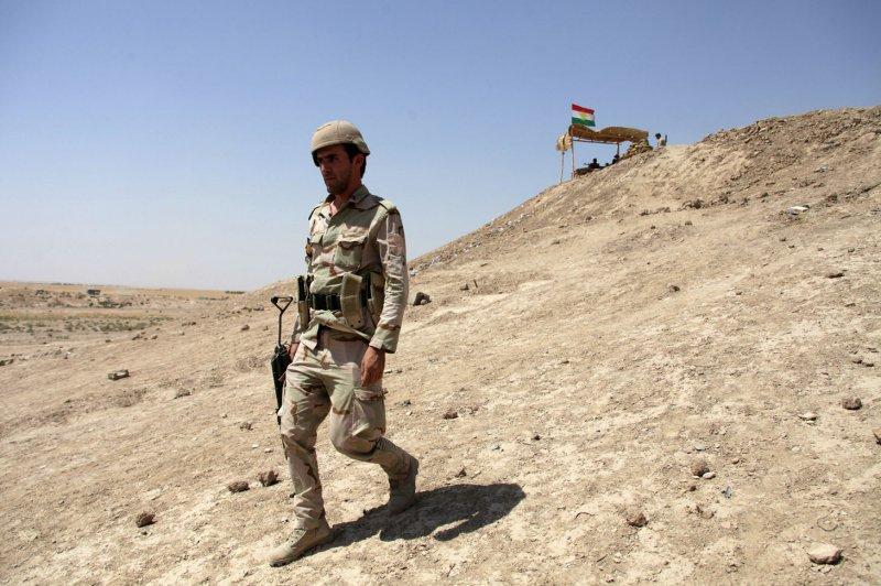 A Kurdish Peshmerga soldier walks in Makhmur town, after Peshmerga took control of the town from Islamic State militants, northwest of Erbil, Kurdistan region, Iraq, August 28, 2014. UPI/Mohammed al Jumaily