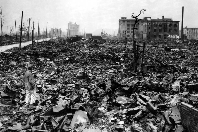 An unidentified newsman stands amid the rubble of Hiroshima in September 1945, a month after the atomic bomb was dropped on the city. The city had a population of roughly 400,000, three-quarters of them were civilians. (UPI/File)