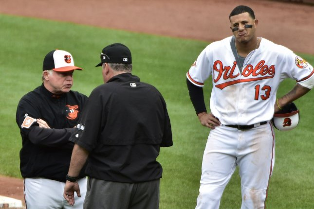 754dcb978d9 ... Buck Showalter (L) talks to umpire Hunter Wendelstedt (C) after Manny  Machado (R) dodged a high pitch from Boston Red Sox relief pitcher Matt  Barnes.