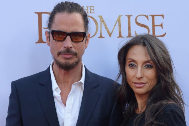 Soundgarden singer Chris Cornell (L) and his wife Vicky Karayiannis attend the premiere of The Promise on April 12, 2017. A moment of silence was held in honor of Cornell at the Billboard Music Awards following his death on Wednesday. File Photo by Jim Ruymen/UPI