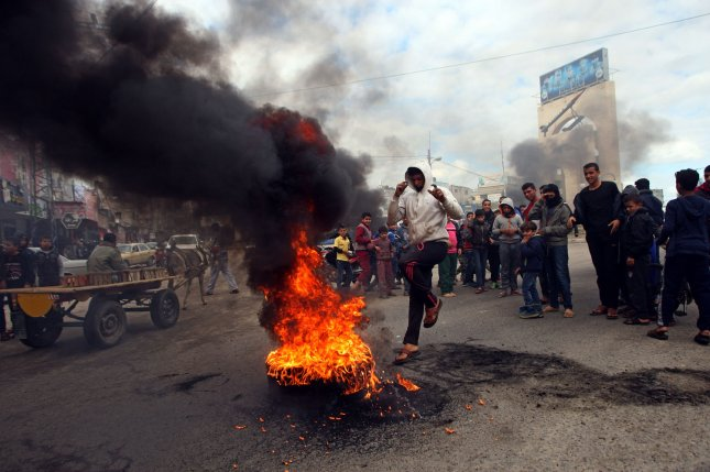 Palestinians burn tires in Khan Younis in the southern Gaza Strip Friday during a protest against U.S. President Donald Trump's decision to recognize Jerusalem as the capital of Israel. Photo by Ismael Mohamad/UPI