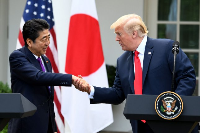 U.S. President Donald Trump (R) and Japanese Prime Minister Shinzo Abe shake hands during their joint news conference in the Rose Garden of the White House on Thursday. Abe is town for one day of talks. Photo by Pat Benic/UPI