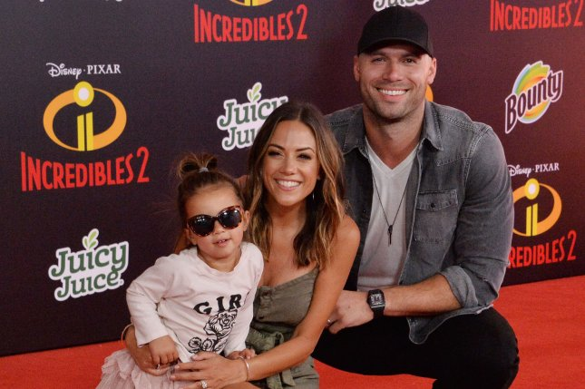 Jana Kramer (C), pictured with Mike Caussin and daughter Jolie, is expecting again with Caussin. File Photo by Jim Ruymen/UPI