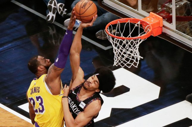 Brooklyn Nets center Jarrett Allen blocks a shot from Los Angeles Lakers forward LeBron James in the first quarter on Tuesday at Barclays Center in New York City. Photo by John Angelillo/UPI