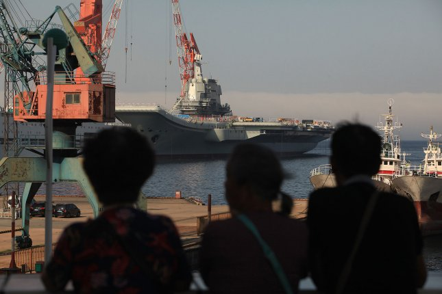 A Chinese aircraft carrier is moored in Dalian, China. A report released on Monday by the Australia-based United States Studies Center said that China's military is now strong enough to dominate the Indo-Pacific region.  File Photo by Stephen Shaver/UPI