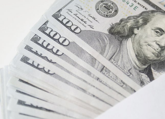 A man who found a bundle of $3,000 cash on a sidewalk in Wausau, Wis., helped police and bank officials return the money to its rightful owner. File Photo by John Angelillo/UPI