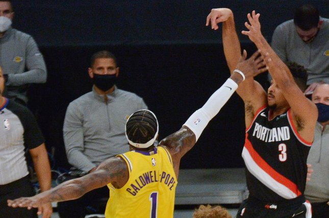Portland Trail Blazers guard C.J. McCollum (3) will miss more than a dozen games due to foot injuries he sustained in a win over the Atlanta Hawks on Sunday in Portland, Ore. File Photo by Jim Ruymen/UPI