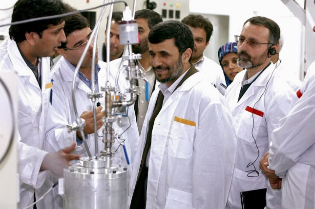 Iran's President Mahmoud Ahmadinejad (C) visits the Natanz uranium enrichment facilities 200 miles (322 km) south of the Tehran, Iran on April 8, 2008. Iran plans to move their uranium-enrichment equipment to Fordow from Natanz. (UPI Photo/President's official website)