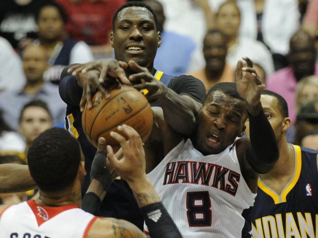 Indiana Pacers' Ian Mahinmi (C) and Atlanta Hawks' Shelvin Mack (8) battle for the rebound during the first half of Game 3 in their Eastern Conference NBA playoff series at Philips Arena in Atlanta, April 24, 2013. UPI/David Tulis