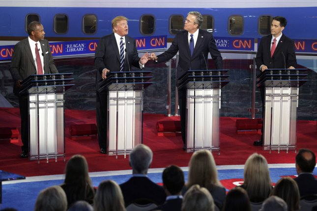 Republican presidential candidates Dr. Ben Carson, from left, businessman Donald Trump, former Florida Gov. Jeb Bush and Wisconsin Gov. Scott Walker square off during the second Republican presidential debate at the Reagan Library in Simi Valley, Calif., on Wednesday. Photo by Max Whittaker/Pool/UPI