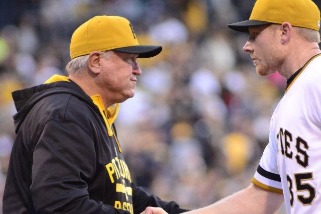 Pittsburgh Pirates manager Clint Hurdle (13) congratulates Pittsburgh Pirates relief pitcher Mark Melancon (35) following the 4-0 win against the Cincinnati Reds at PNC Park in Pittsburgh on October 4, 2015. Photo by Archie Carpenter/UPI