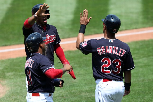 Cleveland Indians Jose Ramirez, Francisco Lindor and Michael Brantley celebrate after they all scored on a double by Brandon Guyer during the first inning of a game against the Toronto Blue Jays at Progressive Field in Cleveland, Ohio on July 23, 2017. File photo by Aaron Josefczyk/UPI