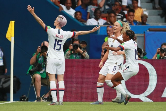 Megan Rapinoe (L) of Team USA is mobbed by her teammates after scoring the first goal of the game during the 2019 FIFA Women's World Cup quarterfinal match against France on Friday at the Parc des Princes near Paris. Photo by David Silpa/UPI