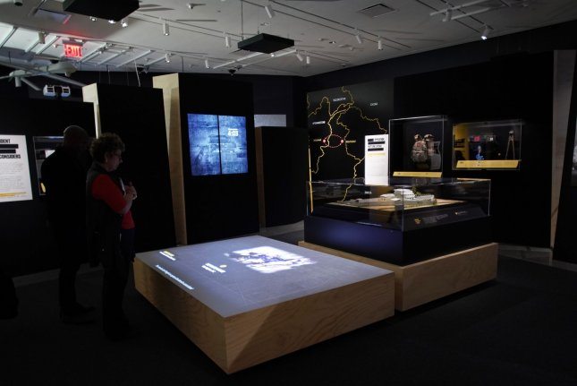 Items related to the search and death of Osama bin Laden are on display Thursday at a press preview for the new exhibition at the September 11 Memorial & Museum. Photo by John Angelillo/UPI