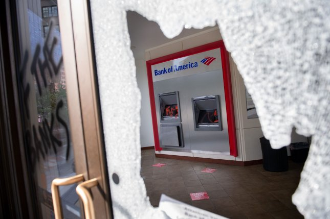 A Bank of America location is seen Monday with damage following protests in Washington, D.C., over the police killing of George Floyd in Minnesota. Photo by Kevin Dietsch/UPI