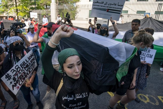 Hundreds of people gathered at the Israeli embassy in Washington, D.C. on Tuesday to protest Israeli airstrikes that have killed more than 200 Palestinians in Gaza since May 10. File Photo by Tasos Katopodis/UPI