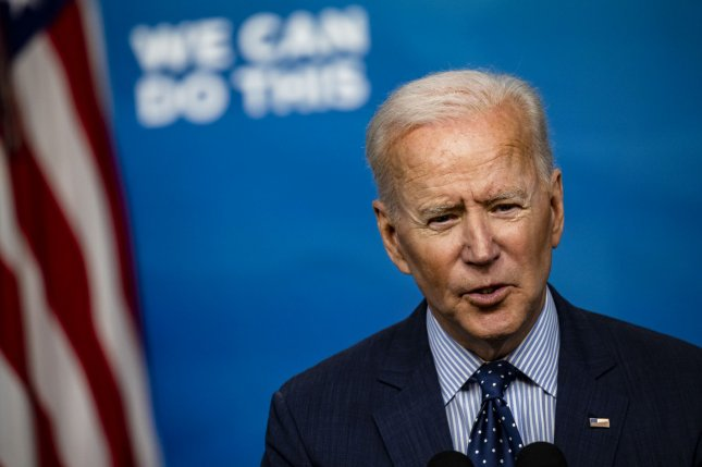President Joe Biden signed an executive order on Thursday expanding a Trump-era ban on investment into Chinese companies to include defense and surveillance technology firms.Photo by Samuel Corum/UPI