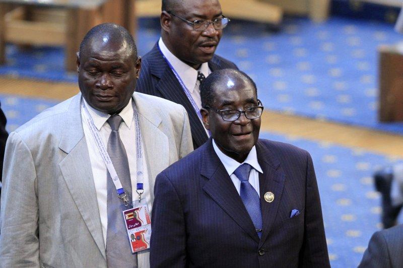 Zimbabwe President Robert Mugabe (R) removed private diamond mining companies from his country on Monday. File Photo by Maryam Rahmanian/UPI