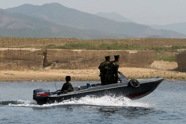 North Korean soldiers patrol the banks of the Yalu River near Sinuiju, across the Yalu River from Dandong, China's largest border city with North Korea. A U.S. official said there are plans to assemble a list of human rights abusers in North Korea. File Photo by Stephen Shaver/UPI