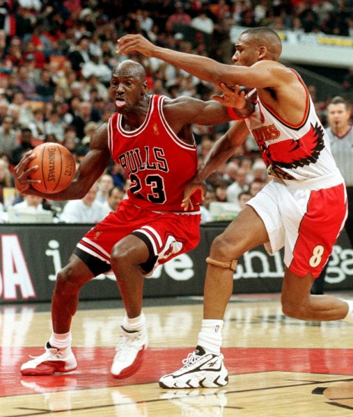 Chicago Bulls Michael Jordan drives past Atlanta Hawks Steve Smith for a layup during the second period February 14, 1997, in Atlanta. The Bulls ended Atlanta's winning streak at 20 games with a 89-88 victory. On March 18, 1995, I'm back. Superstar Michael Jordan announced he was returning to professional basketball and the Chicago Bulls after a 17-month break. File Photo by Jim Middleton/UPI
