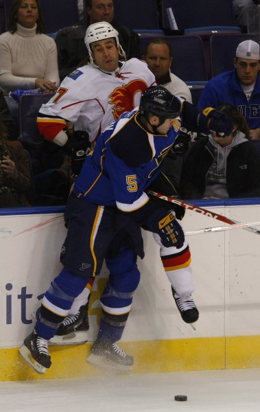 St. Louis defenseman Barrett Jackman (5) tussles with Calgary's Todd Bertuzzi on Dec. 5, 2008. (UPI Photo/Bill Greenblatt)