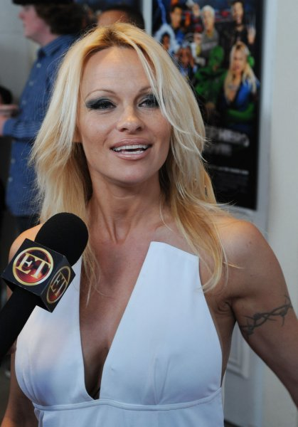 Pamela Anderson, a cast member in the motion picture parody spoof Superhero Movie, attends the premiere of the film in Los Angeles on March 27, 2008. (UPI Photo/Jim Ruymen)