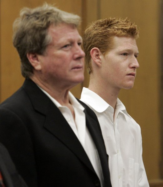 Actor Ryan O'Neal (L) and his son Redmond O'Neal appear for an arraignment on methamphetamine possession charges, at the courthouse in Malibu, Calif., Nov. 11, 2008. (UPI Photo/Reed Saxon/pool)