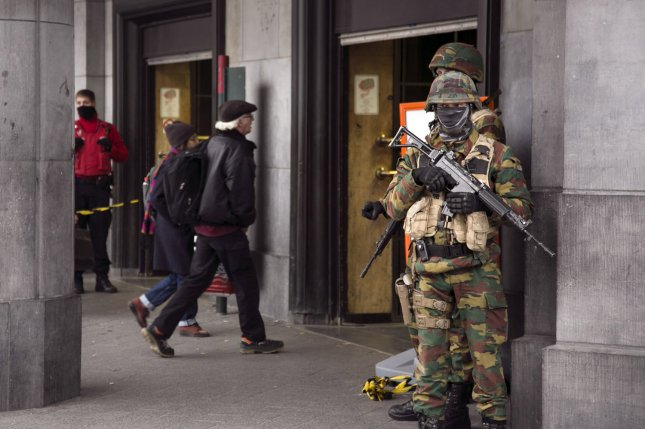 Troops guard a road leading to Zaventem International Airport following coordinated suicide attacks in Brussels, Belgium, Thursday, March 24, 2016. Tuesday, officials said it might take weeks for the airport to full reopen. Photo by Albert Masias/UPI
