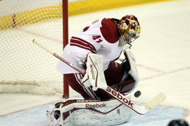 Phoenix Coyotes goaltender Mike Smith stops a shot. File photo by Bill Greenblatt/UPI