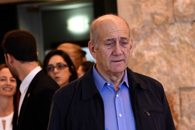 Former Israeli Prime Minister Ehud Olmert leaves the courtroom after the final guilty verdict in his corruption case in in 2015. Olmert could be let out of prison as soon as Sunday after being granted parole. File Photo by Debbie Hill/UPI
