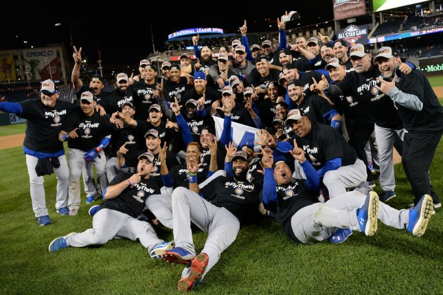 The Chicago Cubs pose for their team picture on the field after beating the Washington Nationals during National League Division Series game 5 at Nationals Park in Washington, D.C. on October 13, 2017. Chicago held off Washington 9-8 to advance to the National League Championship Series against the Los Angeles Dodgers. Photo by Kevin Dietsch/UPI